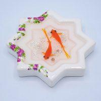 حوض ستاره گلسرخی و ماهی قرمز